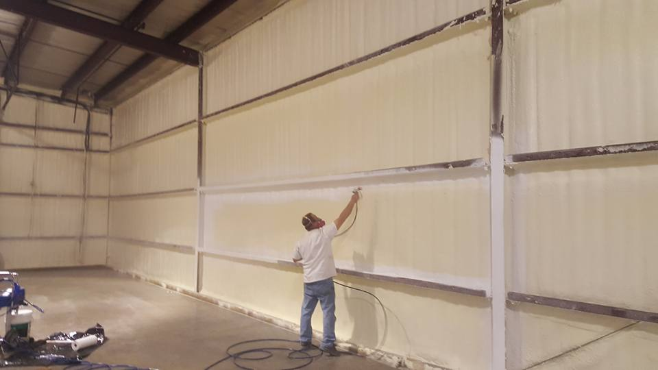 Golden Eagle Insulated Storage, Man Applying Closed Cell Spray Foam and coating to a metal building